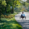 Record-Eagle/Keith King<br /> Tad Minor, of Traverse City, rides his recumbent trike along Center Road on Old Mission Peninsula. Minor rides his trike about 16 miles three to four times a week.