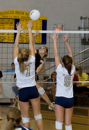 Record-Eagle/Keith King<br /> East Jordan's Valerie Peters goes for the kill as St. Francis' Liza Erickson, left, and Madison Archer jump to defend.