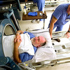 Record-Eagle/Jan-Michael Stump<br /> Justin Windsor, right, removes Michael Dornoff from a hyperbaric chamber after treatment for a leg wound Tuesday at the Munson Medical Center Advanced Wound Center.
