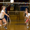 Record-Eagle/Keith King<br /> Traverse City St. Francis' Bailey Ray, left, tracks down a hit as teammate Krissi Dressler looks on during Tuesday's Lake Michigan Conference match with East Jordan. The Gladiators posted a 3-0 victory to improve to 5-1 in the league.