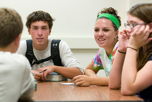 Record-Eagle/Jan-Michael Stump<br /> Traverse City West senior Sydney Denoyer, right, explains homecoming activities to freshmen during an advisory class. The classes, with approximately one senior mentor for five or six freshman,  meet twice a week to help the new students adjust to various parts of high school life.