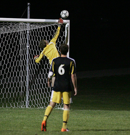 Record-Eagle/Keith King<br /> Traverse City Central goalkeeper Josh Lance deflects the ball away from the goal.