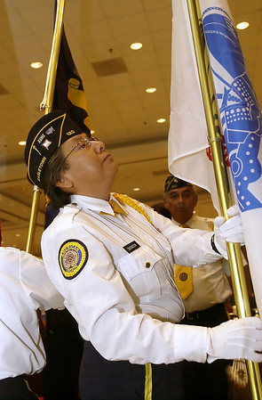 Record-Eagle/Garret Leiva<br /> Leanne Snowden, Eagle Town American Legion Post 120, presents the United States Army flag as part of the color guard during opening ceremonies at the National Indian Council on Aging 2010 biennial conference.