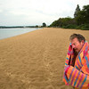 Record-Eagle/Jan-Michael Stump<br /> Ron McCreery, of Traverse City, towels off after a quick swim at a nearly empty Clinch Beach on Monday afternoon. Monday's weather kept many Labor Day celebrations indoors, with occasional rain, clouds and cooler temperatures.