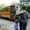 Record-Eagle/Douglas Tesner<br /> Lisa Ritter and daughter Jessica wave goodbye to a bus carrying her son, Matthew, to first-grade classes at Courtade Elementary.