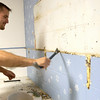 Record-Eagle/Douglas Tesner<br /> John Kose cleans old paint off a bathroom wall at Mt. Holiday during United Way of Northwest Michigan's13th Annual Day of Caring.