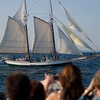 Record-Eagle/Jan-Michael Stump<br /> Crowds line the breakwall at the Clinch Marina as the Madeline and other ships  arrive in West Grand Traverse Bay Friday for the weekend's Schooner Festival.