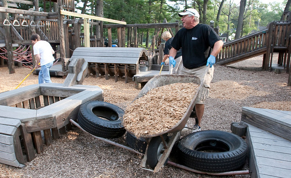 Record-Eagle/Douglas Tesner<br /> Peter Semeyn moves a load of wood chips for the Kids Cove at the Grand Traverse Civic Center during United Way of Northwest Michigan's13th Annual Day of Caring.