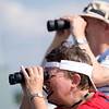 Record-Eagle/Jan-Michael Stump<br /> Debbie Zerfas, front, and her father Carl Zerfas watch for schooners on the horizon as they wait for the ships to arrive in West Grand Traverse Bay Friday evening for the weekend's Schooner Festival.