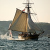 Record-Eagle/Jan-Michael Stump<br /> The armed sloop Welcome fires its cannons as it and other ships arrive in West Grand Traverse Bay Friday for the weekend's Schooner Festival.