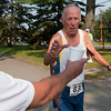 Record-Eagle/Douglas Tesner<br /> Ed Hardy reaches for a drink during the 30th annual Northwest Senior Games Wednesday at the Grand Traverse Civic Center. Hardy, 76, was running the 5K. Seniors will also be competing in events today.