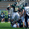 Record-Eagle/Jan-Michael Stump<br /> Traverse City West linebacker Cody Scheuerman (10) celebrates over Saginaw Heritage quarterback Ben Kielat (10) in the second quarter of Friday night's game.