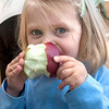 Record-Eagle/Douglas Tesner<br /> Lila Warren, 3, bites into an apple at the Sara Hardy Farmers Market in Traverse City. The market will be open on Wednesdays through the end of the month and on Saturdays until Oct. 31.