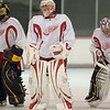 Record-Eagle/Jan-Michael Stump<br /> From left, Chris Whitley, Thomas McCollum and Jordan Pearce warm up during Red Wings prospects camp Saturday.