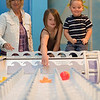 Record-Eagle/Jan-Michael Stump<br /> Kathy Dankert, left, of Holly plays with their grandchildren Hannah, 8, center, and Sean, 4, at the Great Lakes Children's Museum during their Traverse City vacation. The museum was recommended to them by their hotel, and the family spent over two hours there on Friday. Attendance at the Great Lakes Children's Museum is up 64 percent over last year.