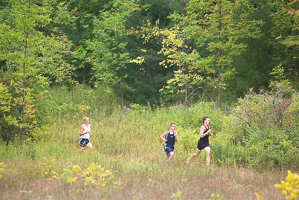 Record-Eagle/Jan-Michael Stump<br /> Traverse City Central's Evan Cover leads Cadillac's Ryan Hearth (center) and Gaylord's Jayden Hesselink (left) in the Traverse City West Cross Country Invitational Tuesday at Hickory Meadows. Cover would go on to win with a time of 17:29.