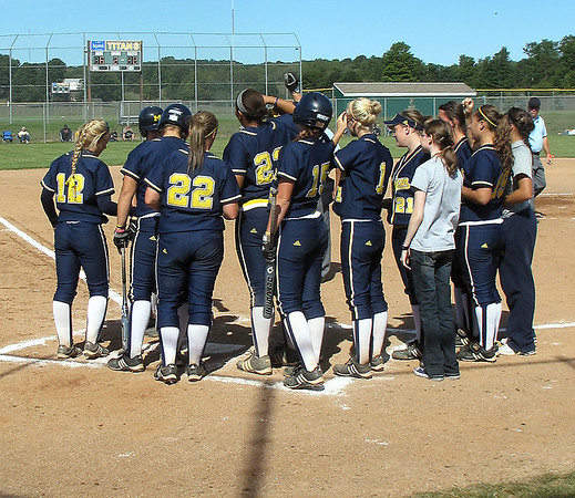 Record-Eagle/Dennis Chase<br /> Michigan's Amanda Chidester is greeted by teammates after hitting a home run.