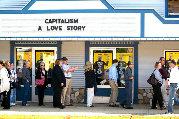 """Record-Eagle/Jan-Michael Stump<br /> People line up outside the Bellaire Theater in Bellaire, Mich, to see filmmaker Michael Moore's film, """"Capitalism: A Love Story,"""" on Saturday, Sept 19, 2009."""