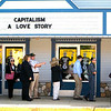 "Record-Eagle/Jan-Michael Stump<br /> People line up outside the Bellaire Theater in Bellaire, Mich, to see filmmaker Michael Moore's film, ""Capitalism: A Love Story,"" on Saturday, Sept 19, 2009."