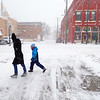 Record-Eagle/Dan Nielsen<br /> A woman and chilld walk along Union Street in Traverse City on Wednesday morning during a snowstorm.