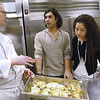 Record-Eagle/Lisa Perkins<br /> Hagerty Center executive chef Coburn MacNaughton talks with Jonathan Madrigal, of Costa Rica, and Nargilya Gasanova, of Turkmenistan, about dishes that will be served for NMC's 9th annual International Student dinner.