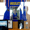 Record-Eagle/Jan-Michael Stump<br /> Mourners stand near pictures and medals of Haley Baldinger, who was laid to rest after a  funeral on Monday in the Buckley Community School Gymnasium.