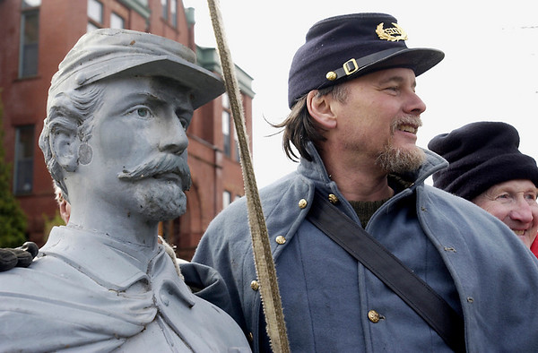 Record-Eagle file photo<br /> Bill Skillman, a member of the Sons of Union Veterans, smiles for a 2004 photo with Traverse City's War Soldier monument.