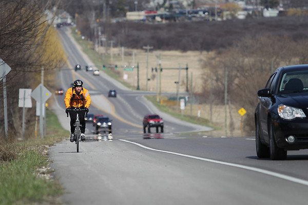 Record-Eagle/Keith King<br /> Sean Cabbage, of Traverse City, pedals his bike Thursday, April 14, 2011 along Silver Lake Road.
