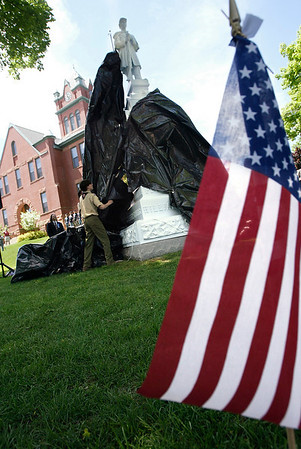 Record-Eagle file photo/Douglas Tesner<br /> The restored Civil War Soldier monument is unveiled at the 2005 Memorial Day re-dedication ceremony on the Grand Traverse County Courthouse lawn.