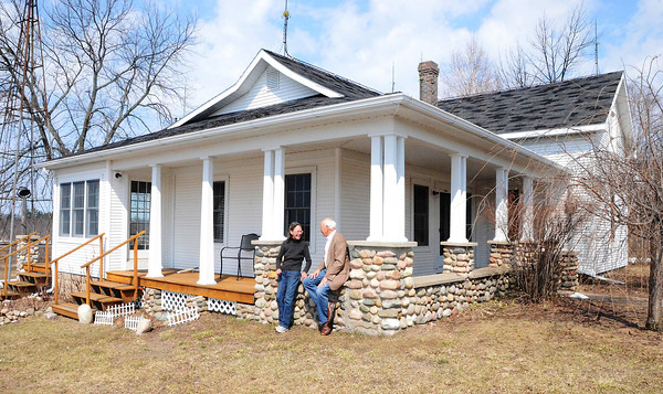 Record-Eagle/Allison Batdorff<br /> Tim Carroll and Colleen Savage chat at the historic family homestead on Old Mission Peninsula. They are the fourth generation to live on the property.