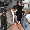 Record-Eagle/Nathan Payne<br /> Cooks Kevin Cryderman and Kyle Johnson unload boxes of supplies into cupboards inside Toasted, a new food trailer at The Little Fleet which will serve brunch anytime. Toasted is a project owned by Harbor 22.