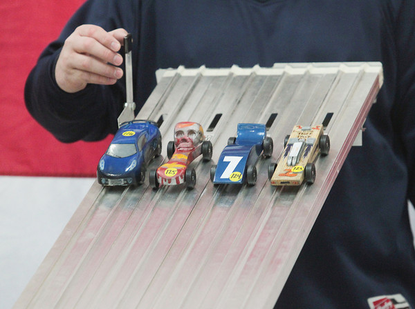 Record-Eagle/Keith King<br /> Cars are released from the starting line during the President Ford Council of the Boy Scouts of America Cub Scout Regional Pinewood Derby at the United States Coast Guard Air Station Traverse City hangar.