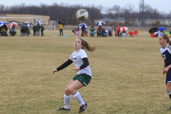 Record-Eagle/Keith King<br /> Traverse City West's Chloe Slack (6) eyes the ball against Cadillac's Sydney Barcey (13) Saturday at the Coast Guard fields in Traverse City.