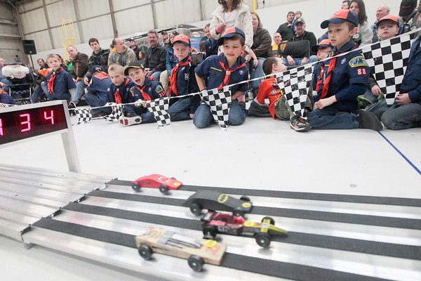 Record-Eagle/Keith King<br /> Cub Scouts and other spectators look on during the President Ford Council of the Boy Scouts of America Cub Scout Regional Pinewood Derby at the United States Coast Guard Air Station Traverse City hangar.