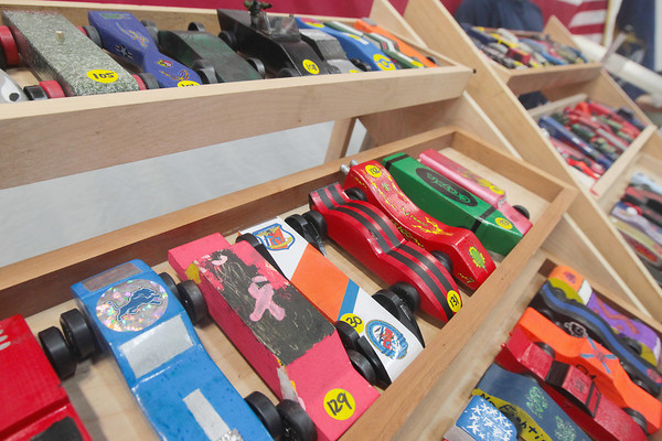 Record-Eagle/Keith King<br /> Pinewood derby cars are arranged prior to being raced in the President Ford Council of the Boy Scouts of America Cub Scout Regional Pinewood Derby at the United States Coast Guard Air Station Traverse City hangar.