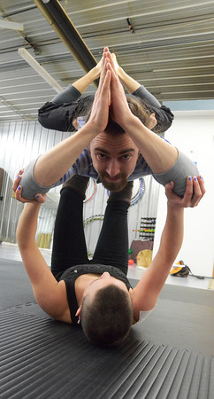 Record-Eagle/Allison Batdorff<br /> Maggie Racich lifts Jimmy Linenberger to demonstrate Acroyoga — one of the diverse classes now offered at Third Space Movement.