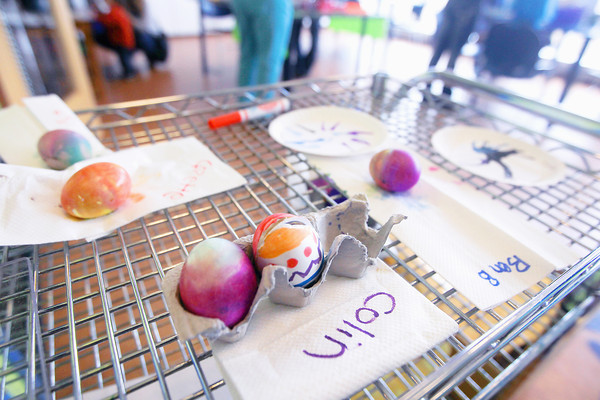 "Record-Eagle/Keith King<br /> Egg-themed art projects dry on a rack during the ""Egg-stravaganza"" event at the Great Lakes Children's Museum in Elmwood Township."
