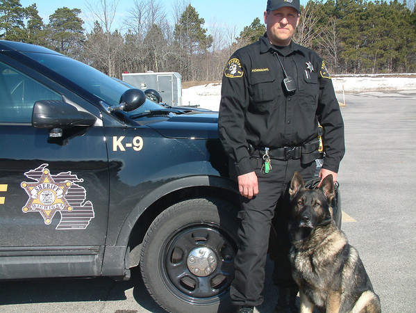 Record-Eagle/Marta Hepler Drahos<br /> Leelanau County Sheriff's Deputy and K-9 handler Greg Hornkohl stands with Nico, the department's dual-purpose K-9.
