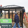 Record-Eagle/Keith King<br /> Chuck Bott, from left, Jerry Stricker and Eric Heinz, with Burkholder Construction, work at Oleson's Plaza East, in Traverse City, on a Bay Area Transportation Authority bus shelter which is to have solar-powered lighting.