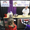 Record-Eagle/Keith King<br /> Mark Tester, co-owner of D & M Culinary Cookware, demonstrates a kitchen cutter Saturday, April 13, 2013 during the 'Up North' Lake and Cottage Show in Howe Arena at the Grand Traverse County Civic Center. The event runs through Sunday.