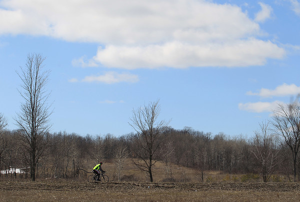 Record-Eagle/Keith King<br /> A bicyclist travels on Cherry Bend Road Tuesday, April 16, 2013 in Elmwood Township.