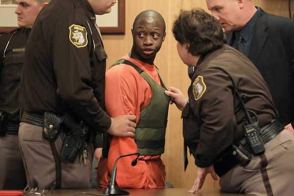 Record-Eagle/Keith King<br /> Law enforcement officers surround Deshawn Stanton during his outburst Tuesday, April 16, 2013 during his sentencing in Benzie County 19th Circuit Court at the Benzie County Government Center.