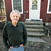Record-Eagle/Keith King<br /> Tom Henderson, stands outside the Williamsburg schoolhouse he's renovating.