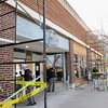 Record-Eagle/Bill O'Brien<br /> Workers put a new facade on shops owned by Zimco Properties in the 300 block of East Front Street.