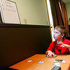 Record-Eagle/Jan-Michael Stump<br /> Alex Hentschel, 7, works on a matching excercise while being tutored by Liz Waligorski, who specializes in children with autism, in her home. The two meet twice a week for two hours, working on language development, academics and diminishing or redirecting certain behaviors.