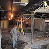 Record-Eagle, Bill O'Brien<br /> A work crew clears out the basement floor of the new Chico's location in downtown Traverse City.