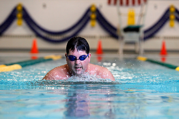 Record-Eagle/Jan-Michael Stump<br /> John Cook swims laps at Easling Pool during an afternoon session. He recently purchased a family membership for himself, his wife and children for the pool. The pool could face cuts as Grand Traverse County looks to slash its budget.
