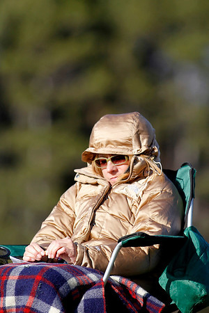 Record-Eagle/Jan-Michael Stump<br /> Therese Smith bundles up to watch her daughter, Boyne City goaltender Lexie Harding, play in Monday's game at Traverse City Liberty in sunny but windy and chilly conditions. Snow could move into the area today, and carry over into Wednesday, with temperatures reaching the upper 40s and lower 30s.