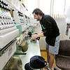 Record-Eagle/Keith King<br /> David Mulliner puts hats on an embroidery machine at JenTees Custom Logo Gear.