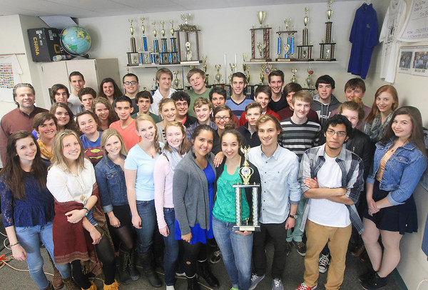 Record-Eagle/Keith King<br /> Traverse City West Senior High School Honors Model United Nations team members, and Charles Rennie, back left, Traverse City West Senior High School teacher and team advisor, stand near trophies that they, and past Traverse City West Senior High School Model United Nations teams, won.